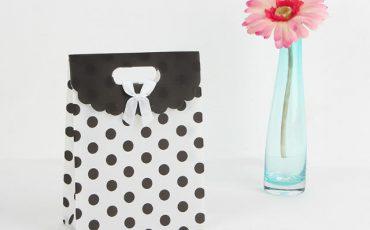 White black polka dot bag
